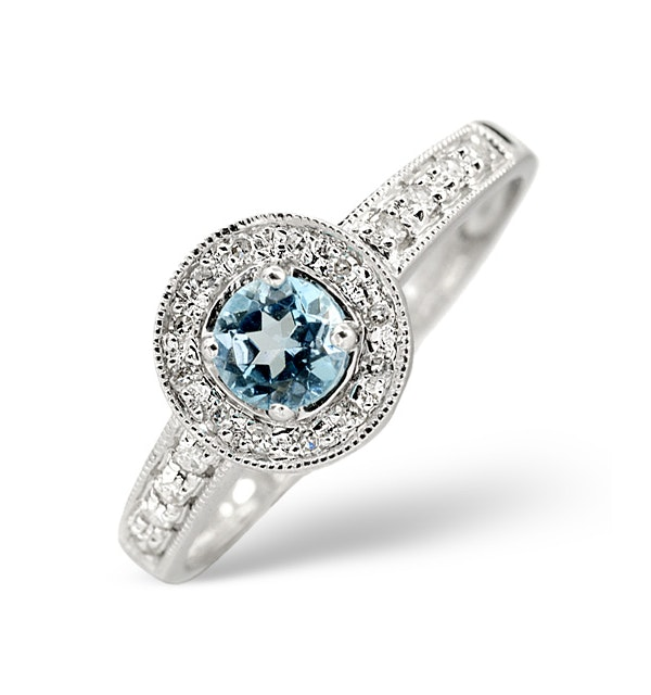 Blue Topaz 0.35CT And Diamond 9K White Gold Ring - image 1