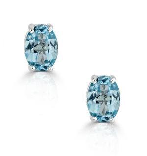Blue Topaz 7 x 5mm and 9K White Gold Earrings