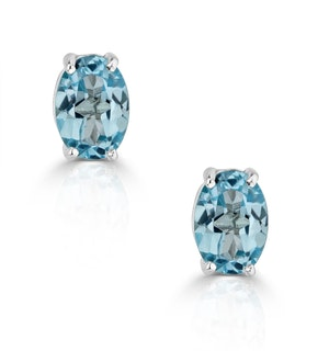 Blue Topaz 7 x 5mm and 9K White Gold Earrings